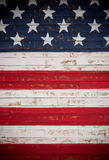 United States flag painted on wooden planks forming a background royalty free stock photo