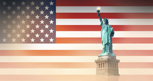 United States flag and Statue of Liberty Stock Photography