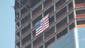 United States flag. Waving in an unfinished building in the Ground Zero stock video footage