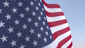 United States flag waving in the wind. On blue sky stock footage