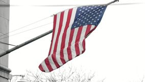 United States flag waving in the wind. Telephoto stock video footage