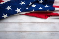 American flag on a white worn wooden background with copy space Royalty Free Stock Photography