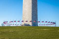 United States flags around base of Washington Monument - Washington, D.C., USA royalty free stock photography