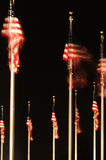 United States flags at night Royalty Free Stock Photos