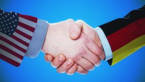 United States - Germany / Handshake concept animation about countries and politics / With matte channel. Handshaking of the men wearing flag pattern suit 4K stock video