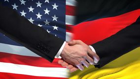 United States and Germany handshake, international friendship, flag background. Stock footage stock video footage