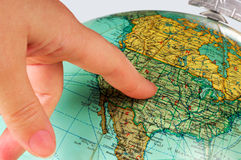 United States on the globe. Image shows an old terrestrial globe with a finger pointing at the United States royalty free stock image