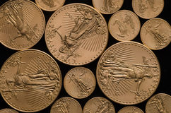 United States Gold Eagle Coins (1 & .1 ounces). On black background royalty free stock photos