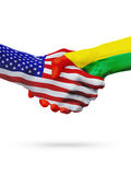 United States, Guinea-Bissau flags concept cooperation, business, sports competition. United States, Guinea-Bissau, countries flags, handshake concept stock image