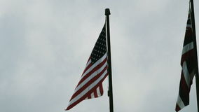 United States And Hawaii State Flag Flying Together On Flag Poles stock footage