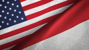 United States and Indonesia two flags textile cloth, fabric texture. United States and Indonesia flags together textile cloth, fabric texture royalty free stock photo