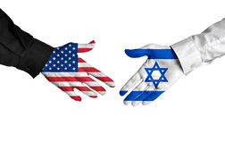 United States and Israel leaders shaking hands on a deal agreement. Hands of two important leaders with national flags for the countries of the United States and Stock Photography
