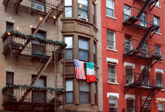 United States and Italy flags at the balcony in Little Italy Royalty Free Stock Photography