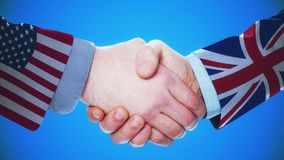 United States - United Kingdom / Handshake concept animation about countries and politics / With matte channel. Handshaking of the men wearing flag pattern suit stock footage