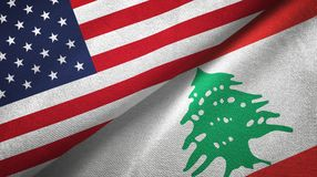 United States and Lebanon two flags textile cloth, fabric texture. United States and Lebanon flags together textile cloth, fabric texture royalty free stock images