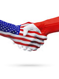 United States and Malta flags concept cooperation, business, sports competition. United States and Malta, countries flags, handshake concept cooperation royalty free stock photo