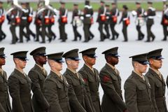 United States Marine Corps Graduates and Band. Brand new United States Marine Corps graduates parade in review with the Marine Corps band are visible in the Royalty Free Stock Image