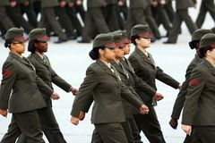 United States Marine Corps Graduates in step. Brand new female United States Marine Corps graduates parade in review during a recruit graduation ceremony at the Stock Image