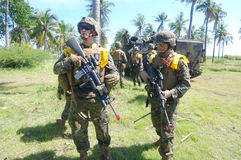 United States Marine forces in Indonesia. United States Marine forces conducting combat training when the parameters along with the Marines at the Banongan coast Stock Photos