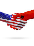 United States and Morocco flags concept cooperation, business, sports competition. United States and Morocco, countries flags, handshake concept cooperation stock photo