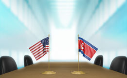 United States and North Korea relations and diplomatic talks, 3D rendering. 3D rendered scene of miniature flags from the United States and North Korea at a Stock Images