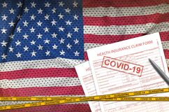 Free United States Of America Flag And Health Insurance Claim Form With Covid-19 Stamp. Coronavirus Or 2019-nCov Virus Concept Royalty Free Stock Photography - 176678677