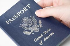 United States Passport. Closeup of an American passport held by a female hand Royalty Free Stock Photos
