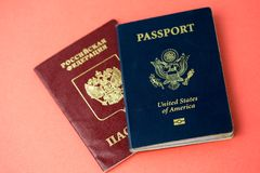 United States passport on top of a Russian passport Royalty Free Stock Image