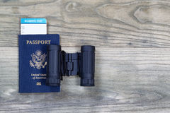 United States Passport and Binoculars on wood Royalty Free Stock Photo