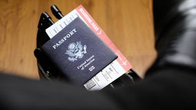 United States passport and boarding pass on bag Royalty Free Stock Image