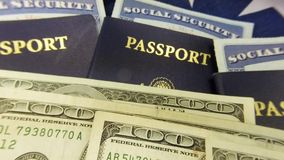 United States passport and currency with social security card - Travel documents tourism concept. United States passport, American flag one hundred dollar bills stock footage