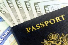 United States passport with one hundred dollar bills Royalty Free Stock Image