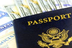 United States passport with one hundred dollar bills. Travel Documents - USA Passport with American Currency Royalty Free Stock Image