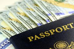 United States passport with one hundred dollar bills. Travel Documents - USA Passport with American Currency Stock Photos