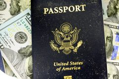 United States passport with one hundred dollar bills Stock Photo