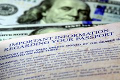 United States passport with one hundred dollar bills Royalty Free Stock Images