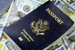 United States passport with one hundred dollar bills Stock Image