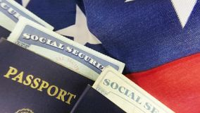 United States passport with social security card - Travel documents tourism concept. United States passport, American flag and social security card stock video