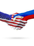 United States and Philippines flags concept cooperation, business, sports competition. United States and Philippines, countries flags, handshake concept stock image