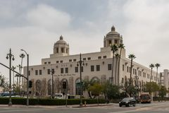 United States Post Office Terminal, Los Angeles California. Los Angeles, CA, USA - April 5, 2018: Large two-tower beige historic United States Post Office royalty free stock photo