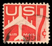 Stamp printed in US showing air mail symbols and the print Air Mail. United States postage stamp in the value of 7c used for overseas air mail deliveries showing royalty free stock photography