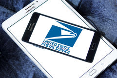 United states postal service logo. Logo of united states postal service on samsung mobile phone on samsung tablet stock image