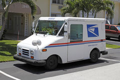 United States Postal Service Truck. FORT-LAUDERDALE, FL, USA - JUNE 5, 2014: One white, blue and red United States Postal Service truck used to deliver mail Stock Image