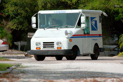 United States Postal Service truck van. View from the gravel driveway of residential home of a United States Postal Service truck van on a residential country Stock Photography