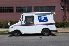 United States Postal Service USPS truck parked in a street of the city of New Orleans in Louisiana. New Orleans, Louisiana - June 17, 2014: United States Postal royalty free stock image