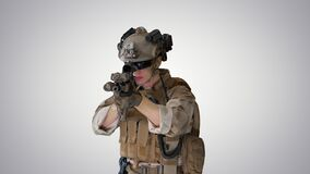 United states ranger aiming with assault rifle while walking on gradient background.