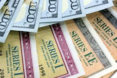 United States Savings Bonds with American Currency Royalty Free Stock Photography