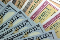 United States Savings Bonds with American Currency Royalty Free Stock Image