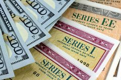 United States Savings Bonds with American Currency Stock Image