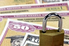 United States Savings Bonds with padlock - Financial security concept Royalty Free Stock Photos